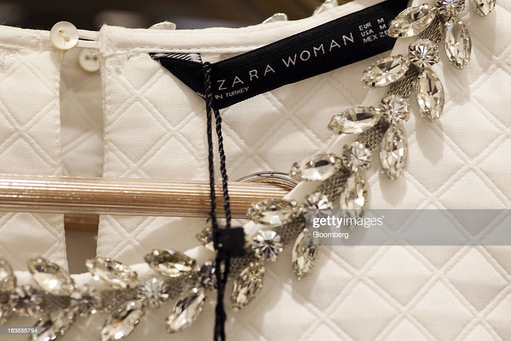 A 'Zara Woman' logo is displayed on a clothing label inside a Zara fashion store, operated by Inditex SA, in Madrid, Spain, on Tuesday, March 12, 2013. Europe's richest man, Amancio Ortega, the 76-year-old founder of Inditex SA, the world's biggest clothing retailer and owner of the Zara clothing chain, is No. 3 on Standard & Poor's 500 Index with a net worth of $57.4 billion, $4.9 billion ahead of Warren Buffett, 82. Photographer: Angel Navarrete/Bloomberg via Getty Images