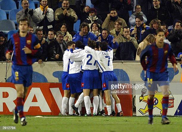 Zaragoza players react after their Spanish King's Cup quarter final second leg match against FC Barcelona at Romareda stadium in Zaragoza 29 January...
