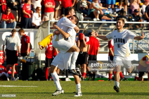 Zarek Valentin and Chad Barson of the University of Akron celebrate after defeating the University of Louisville during the Division I Men's Soccer...