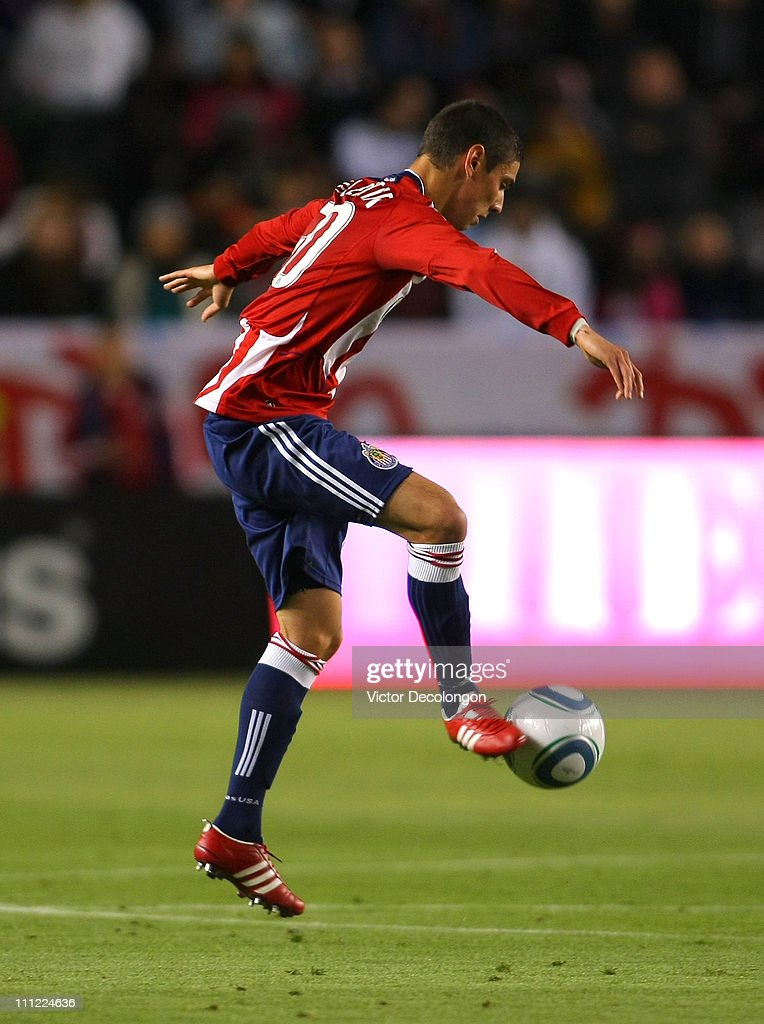 Zarek Valentin of Chivas USA controls the ball during the MLS match against Sporting Kansas City at The Home Depot Center on March 19 2011 in Carson...