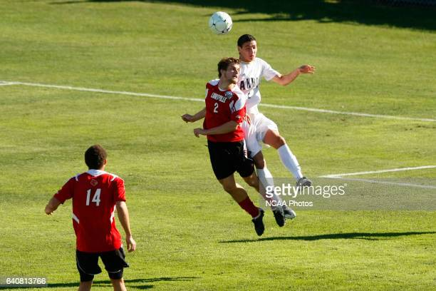 Zarek Valentin of the University of Akron and Charlie Campbell of the University of Louisville battle for a header during the Division I Men's Soccer...