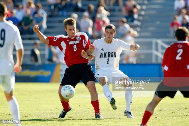 Zarek Valentin of the University of Akron and Colin Rolfe of the University of Louisville battle for the ball during the Division I Men's Soccer...