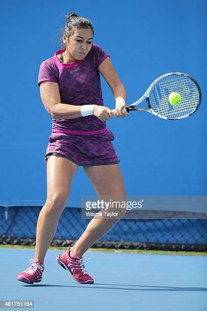 Zarina Diyas of Kazakhstan plays a backhand in her first round match against Urszula Radwanska of Poland during day one of the 2015 Australian Open...