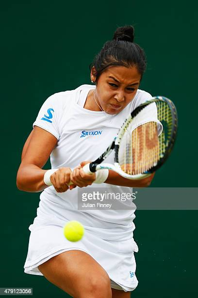Zarina Diyas of Kazakhstan plays a backhand in her Ladies Singles Second Round match against Aliaksandra Sasnovich of Belarus during day three of the...