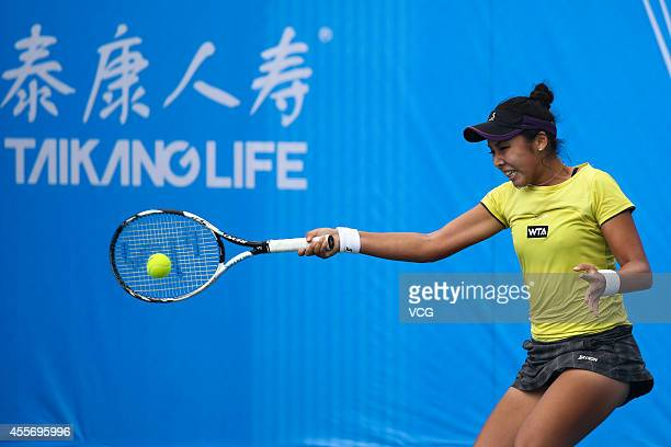 Zarina Diyas of Kazakhstan returns a ball in the qualifying match against Sorana Cirstea of Romania prior to the start of 2014 WTA Wuhan Open at...