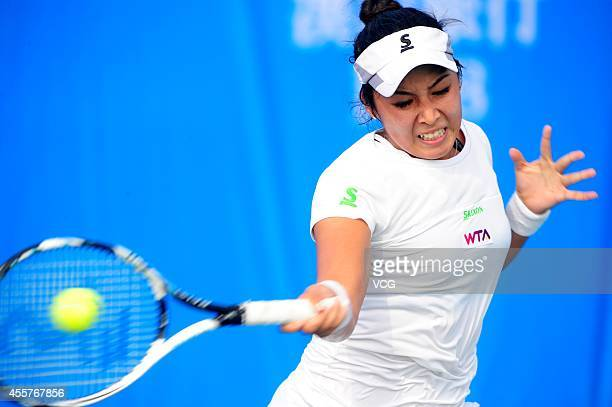 Zarina Diyas of Kazakhstan returns a ball in the qualifying match against Silvia SolerEspinosa of Spain prior to the start of 2014 WTA Wuhan Open at...