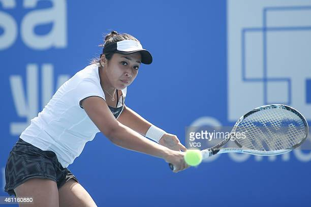 Zarina Diyas of Kazakhstan returns a shot against Zheng Saisai of China on day five of WTA Shenzhen Open at Longgang Sports Center on January 8 2015...