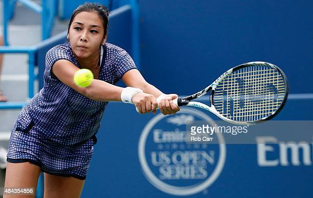 Zarina Diyas of Kazakhstan returns a shot to Venus Williams during Day 3 of the Western Southern Open at the Linder Family Tennis Center on August 17...