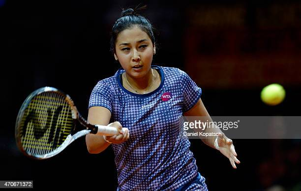 Zarina Diyas of Kazakhstan returns during her first round match against Sabine Lisicki of Germany on day three of the Porsche Tennis Grand Prix at...