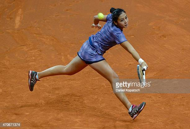Zarina Diyas of Kazakhstan returns during her first round match against Sabine Lisicki of Germany on day three of the Porsche Tennis Grand Prix at...