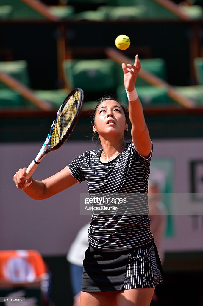 <a gi-track='captionPersonalityLinkClicked' href=/galleries/search?phrase=Zarina+Diyas&family=editorial&specificpeople=6975998 ng-click='$event.stopPropagation()'>Zarina Diyas</a> of Kazakhstan serves during her women's single second round match against Simona Halep of Romania on day four of the 2016 French Open at Roland Garros on May 25, 2016 in Paris, France.