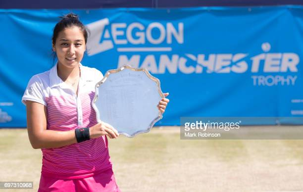 Zarina Diyas of Kazakhstan with her winner's trophy after her Women's Final match during the Aegon Manchester Trophy on June 18 2017 in Manchester...