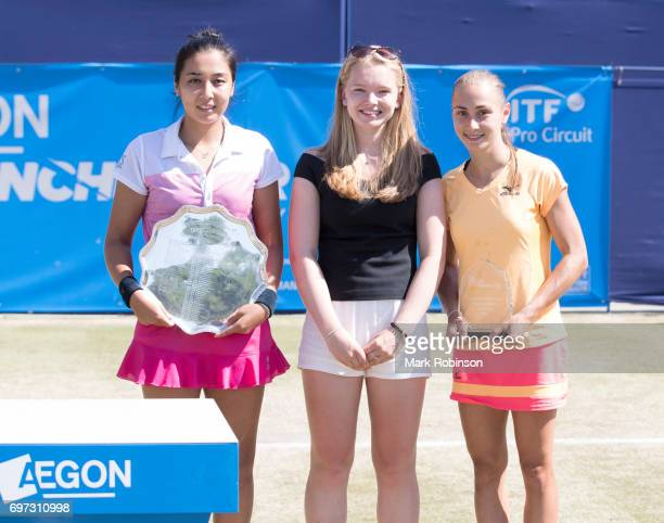 Zarina Diyas of Kazakhstan with her winner's trophy and Aleksandra Krunic of Russia with her runners up trophy presented by Holly Staff after their...