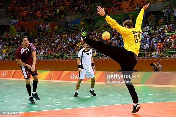 Zarko Markovic of Qatar fails to score against Andreas Wolff of Germany during the Men's Quarterfinal Handball contest at Future Arena on Day 12 of...