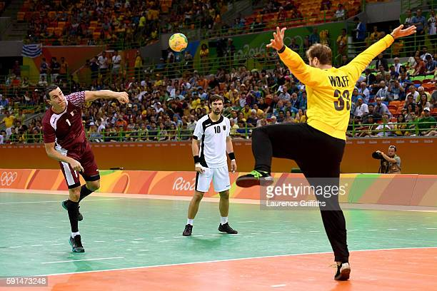 Zarko Markovic of Qatar takes a shot against Andreas Wolff of Germany during the Men's Quarterfinal Handball contest at Future Arena on Day 12 of the...