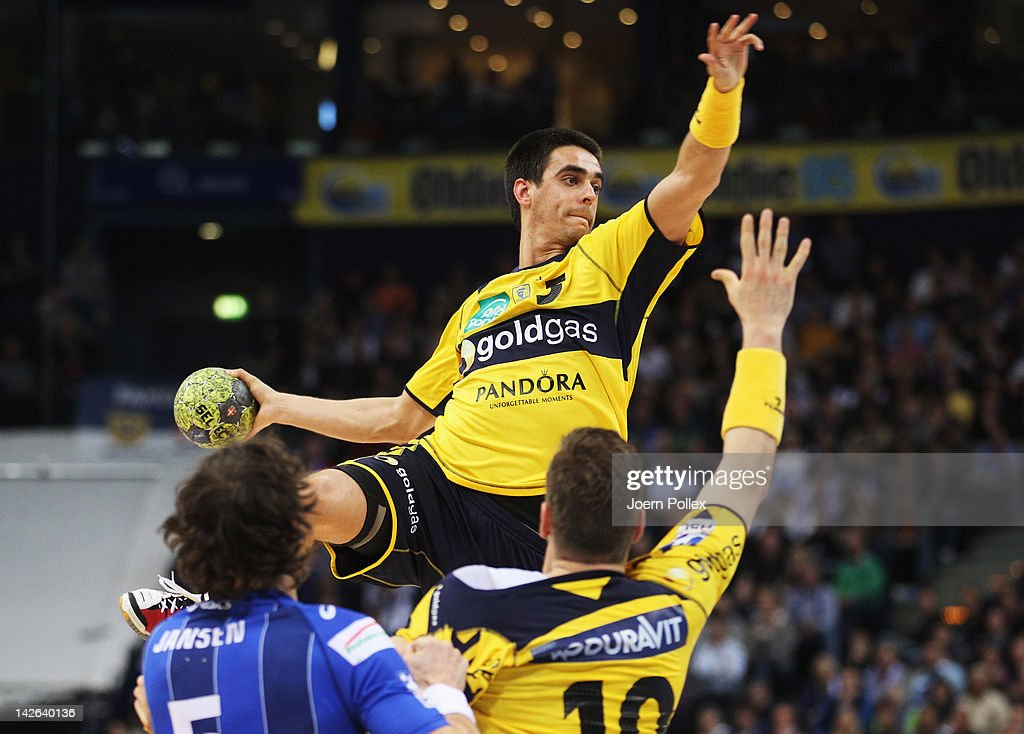 Zarko Sesum of Rhein-Neckar Loewen scores during the Toyota Bundesliga handball game between HSV Hamburg and Rhein-Neckar Loewen at the O2 World on April 10, 2012 in Hamburg, Germany.