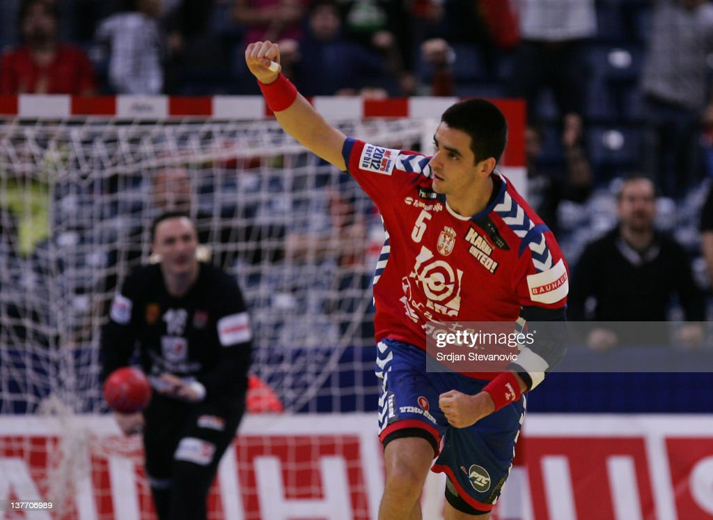 Zarko Sesum (R) of Serbia celebrates a goal during the Men's European Handball Championship 2012 second round group one match between Serbia and Macedonia at Arena Hall on January 25, 2012 in Belgrade, Serbia.