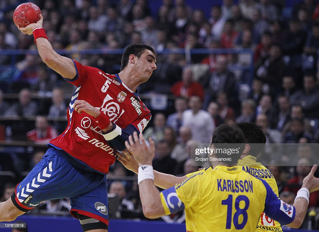 Zarko Sesum (L) of Serbia jump to scores over Tobias Karlsson (R) of Sweden during the Men's European Handball Championship 2012 second round group one match between Serbia and Sweden at Arena Hall on January 23, 2012 in Belgrade, Serbia.