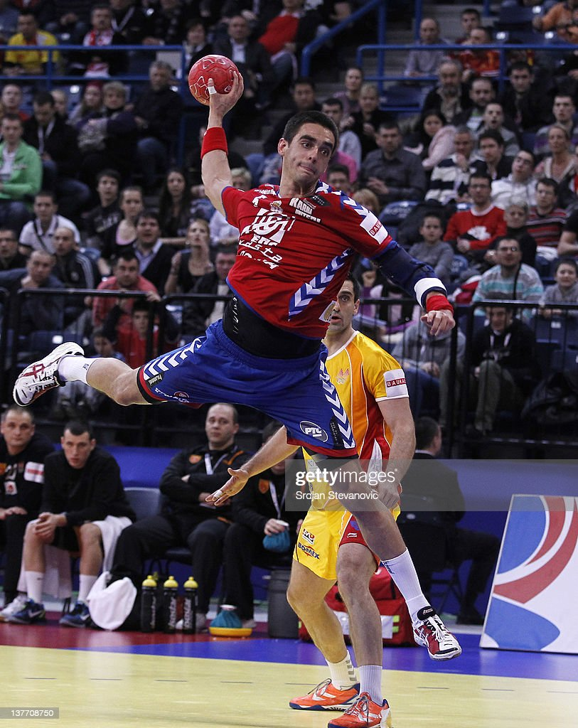 Zarko Sesum (L) of Serbia jumps to score past <a gi-track='captionPersonalityLinkClicked' href=/galleries/search?phrase=Kiril+Lazarov&family=editorial&specificpeople=3239733 ng-click='$event.stopPropagation()'>Kiril Lazarov</a> (R) of Macedonia during the Men's European Handball Championship 2012 second round group one, match between Serbia v Macedonia at Arena Hall on January 25, 2012 in Belgrade, Serbia.