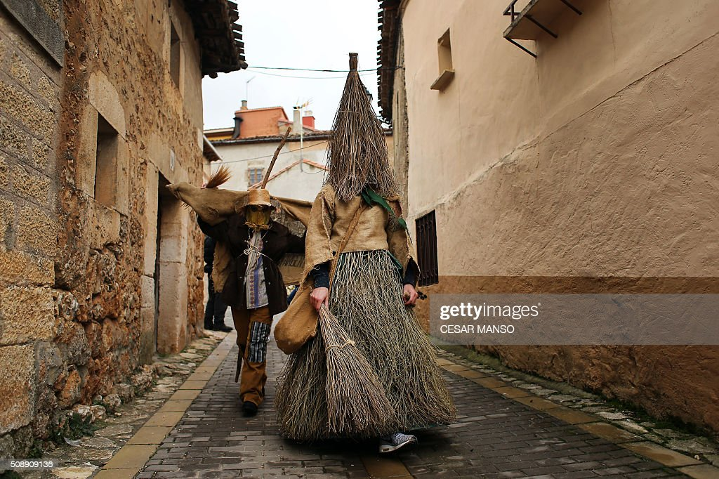 A 'Zarramaco' walks the street during the celebration of 'El Gallo de Carnaval' (The Carnival's Cock) in Mecerreyes, in the northern Spanish province of Burgos, on February 7, 2016. The Gallo Carnival is a pagan festival in which people participate singing, dancing and attacking the 'Gallo' that is defended by Zarramacos. AFP PHOTO / CESAR MANSO / AFP / CESAR MANSO