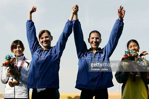 Zarrina Ganieva and Sevara Ganiyeva of Team Uzbekistan hlod their Gold Medal in the Women's Lightweight Double Sculls Rowing Competition during the...