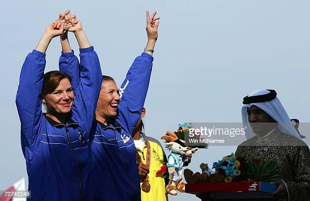 Zarrina Ganieva and Sevara Ganiyeva of Team Uzbekistan wave to the crowd after winning the Gold Medal in the Women's Lightweight Double Sculls Rowing...