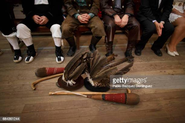 Zarrons leave their hat and sticks on the floor as they attend a mass during the Zarron festival on May 17 2017 in Almazan Soria province Spain El...