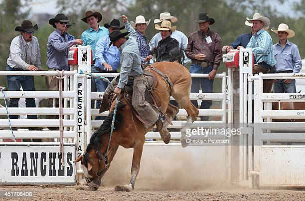 Zary May competes in the Bronc Riding at the Prescott Frontier Days 'World's Oldest Rodeo' on July 4 2014 in Prescott Arizona