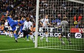 Zat Knight of Bolton scores an own goal against Bolton during the Barclays Premier League match between Bolton and Chelsea at the Reebok Stadium on...