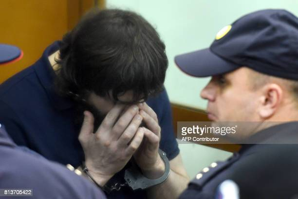 Zaur Dadayev one of five men convicted of organising and carrying out the contract killing of opposition leader Boris Nemtsov reacts during the...
