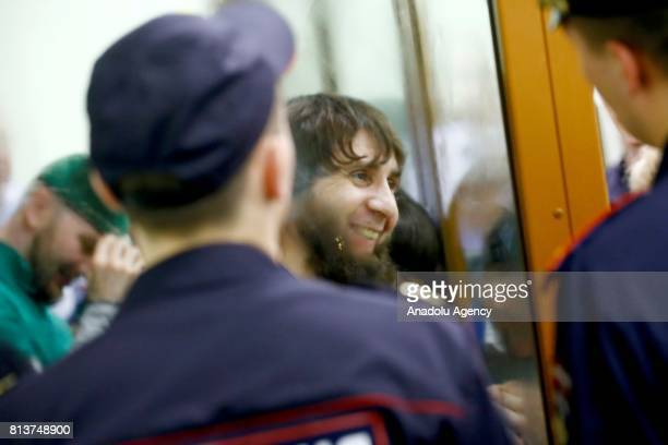 Zaur Dadayev who is convicted of organizing and carrying out the contract killing of opposition leader Boris Nemtsov stands inside a glass...