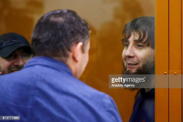 Zaur Dadayev who is convicted of organizing and carrying out the contract killing of opposition leader Boris Nemtsov stand inside a glass defendant's...
