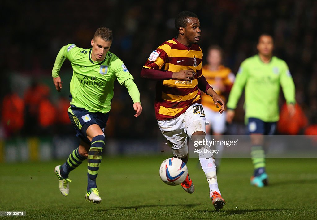 Zavon Hines of Bradford City beats Joe Bennett of Aston Villa during the Capital One Cup Semi-Final 1st Leg match between Bradford City and Aston Villa at Coral Windows Stadium, Valley Parade on January 8, 2013 in Bradford, England.