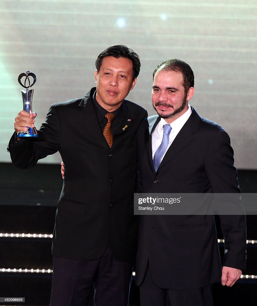 Zaw Zaw (L), President of Myanmar Football Association, poses with his AFC Dream Asia Award for his Association from the Prince of Jordan HRH Prince Ali Bin Hussein during the 2013 AFC Annual Awards at the Mandarin Oriental on November 26, 2013 in Kuala Lumpur, Malaysia.