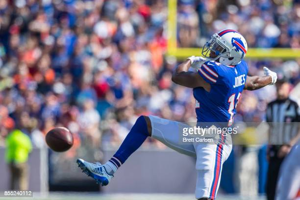 Zay Jones of the Buffalo Bills flails as he struggles to reach a pass thrown behind him during the first half against the Denver Broncos on September...