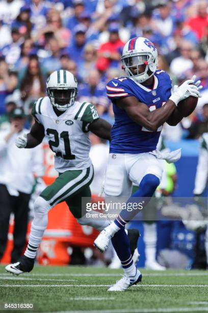 Zay Jones of the Buffalo Bills runs with the ball as Morris Claiborne of the New York Jets attempts to defend him during the first half on September...