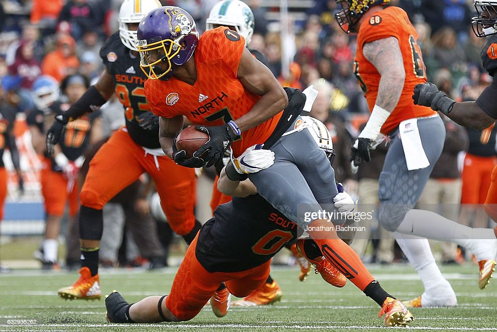 Zay Jones #7 of the North team catches the ball as Duke Riley #0 of the South team defends during the second half of the Reese's Senior Bowl at the Ladd-Peebles Stadium on January 28, 2017 in Mobile, Alabama.
