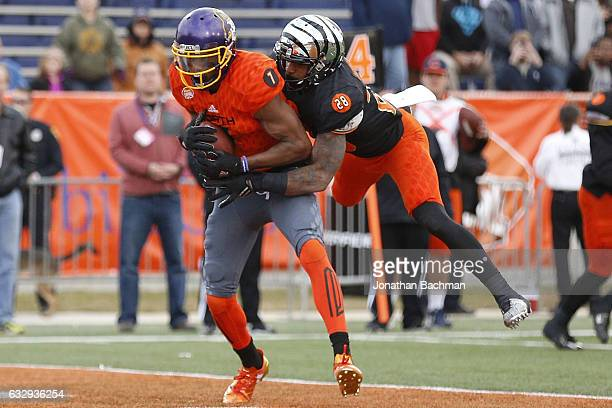 Zay Jones of the North team catches the ball as Maulet Arthur of the South team defends during the second half of the Reese's Senior Bowl at the...
