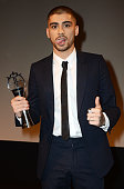 REQUIRED Zayn Malik accepts his award for Outstanding Achievement in Music during The Asian Awards 2015 at The Grosvenor House Hotel on April 17 2015...