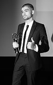 Image has been converted to black and white Zayn Malik accepts his award for Outstanding Achievement in Music during The Asian Awards 2015 at The...