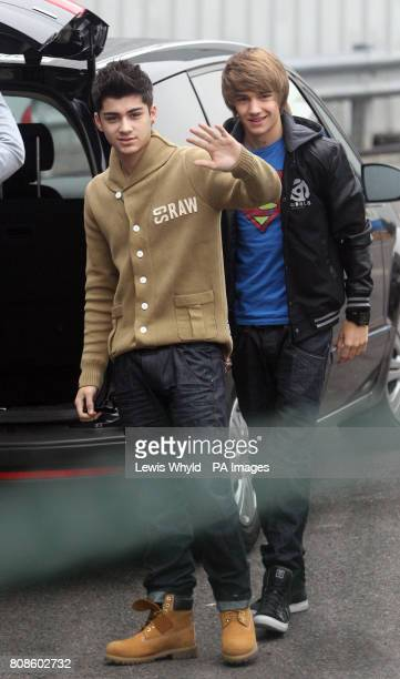 Zayn Malik and Liam Payne of One Direction arrive at Fountain Studios for the XFactor