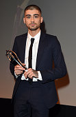 Zayn Malik collects his award for Outstanding Achievement in Music at the The Asian Awards 2015 at The Grosvenor House Hotel on April 17 2015 in...