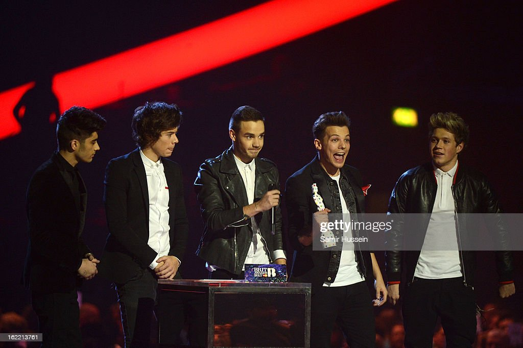 Zayn Malik, Harry Styles, Liam Payne, Louis Tomlinson and Niall Horan of One Direction receive the Brits Global Success Award on stage during the Brit Awards 2013 at the 02 Arena on February 20, 2013 in London, England.