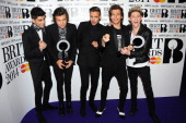 Zayn Malik Harry Styles Liam Payne Louis Tomlinson and Niall Horan of One Direction winner of the British Video and Global Success BRIT awards pose...