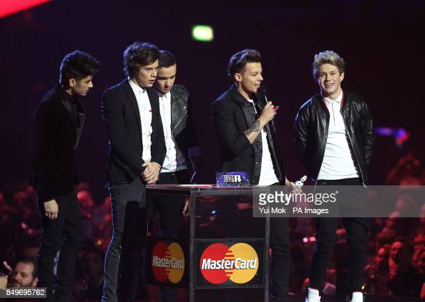 Zayn Malik Harry Styles Liam Payne Louis Tomlinson and Niall Horan of One Direction collect the Global Success Award award during the 2013 Brit...