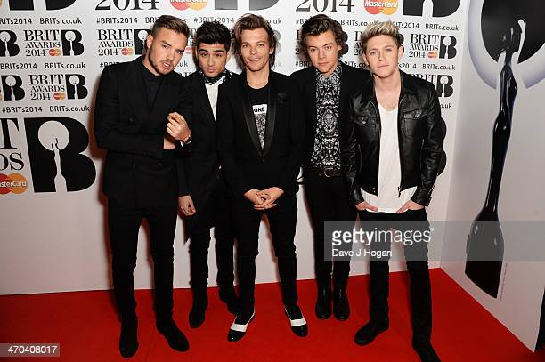 Zayn Malik Harry Styles Louis Tomlinson Liam Payne and Niall Horan of One Direction attend The BRIT Awards 2014 at The O2 Arena on February 19 2014...