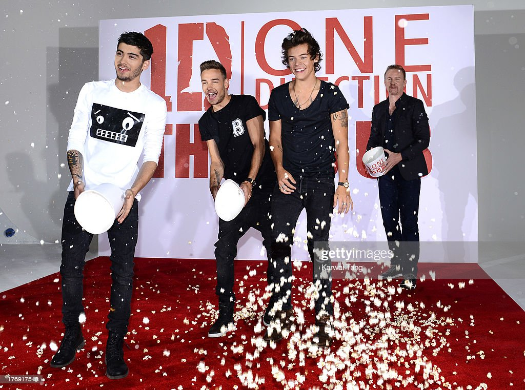 Zayn Malik, Liam Payne and Harry Styles of One Direction with Morgan Spurlock attend a photocall to launch their new film 'One Direction: This Is Us 3D' held at the Blue Sky Studios on August 19, 2013 in London, England.