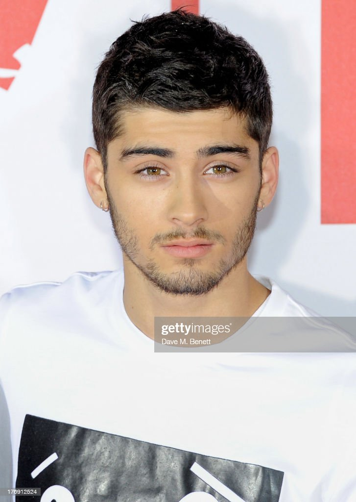 <a gi-track='captionPersonalityLinkClicked' href=/galleries/search?phrase=Zayn+Malik&family=editorial&specificpeople=7298822 ng-click='$event.stopPropagation()'>Zayn Malik</a> of One Direction attends a photocall to launch their new film 'One Direction: This Is Us 3D' at Big Sky Studios on August 19, 2013 in London, England.