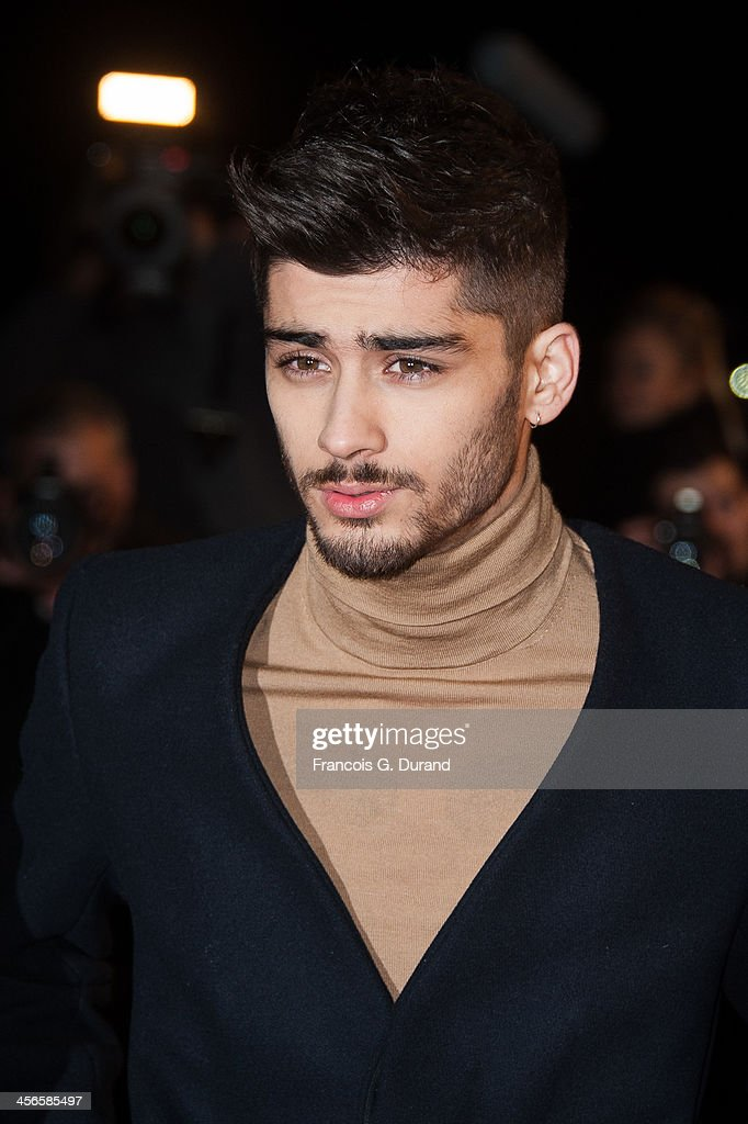 Zayn Malik of One Direction attends the 15th NRJ Music Awards at Palais des Festivals on December 14, 2013 in Cannes, France.