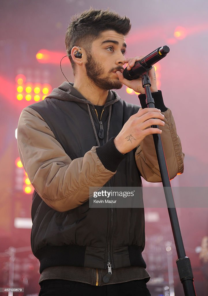 Zayn Malik of One Direction performs on ABC's 'Good Morning America' at Rumsey Playfield, Central Park on November 26, 2013 in New York City.